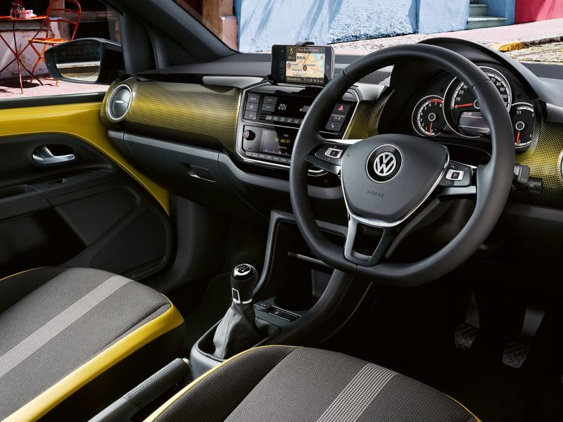 Interior shot of a Volkswagen up!, steering wheel and dashboard.