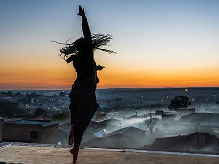 Kitty dancing on the rooftop