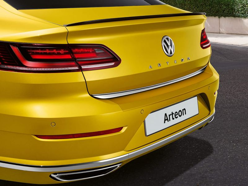 Rear shot of a yellow Volkswagen Arteon's prominent lettering on the boot.