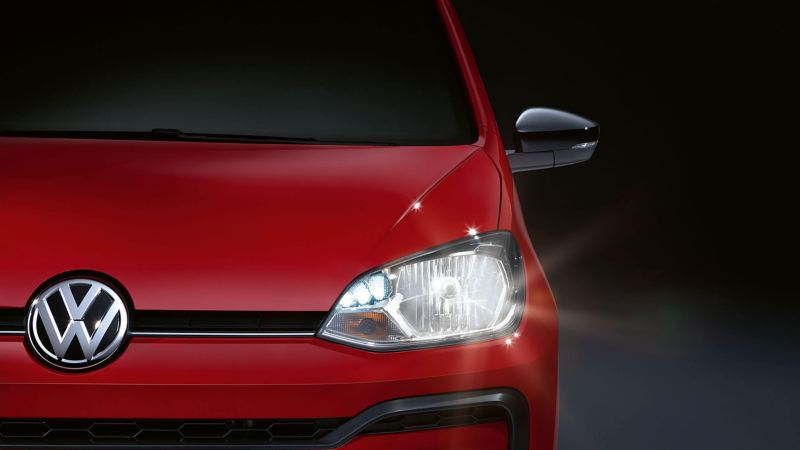 LED headlight close up of a red Volkswagen up!