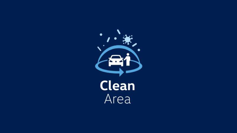 Logotipo de Clean Area de Volkswagen sobre fondo azul oscuro