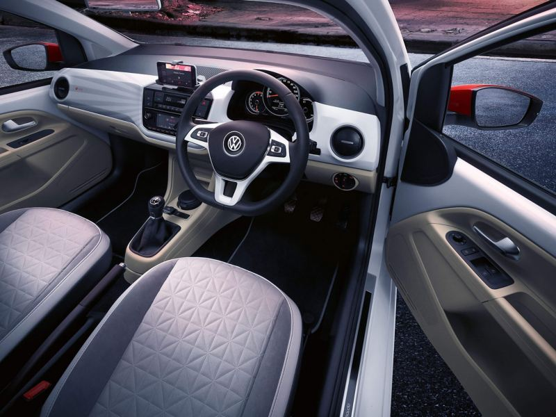 Interior shot of a Volkswagen up! Beats, steering wheel and dashboard.