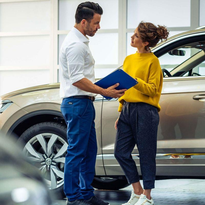 A customer at her Volkswagen retailer