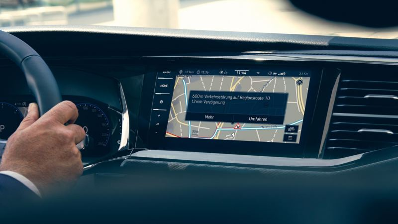 The navigation device in a Volkswagen commercial vehicle showing the real-time navigation in use.