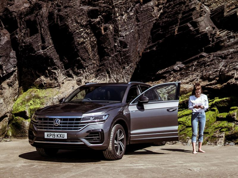 Touareg beside a mountain with a woman outside