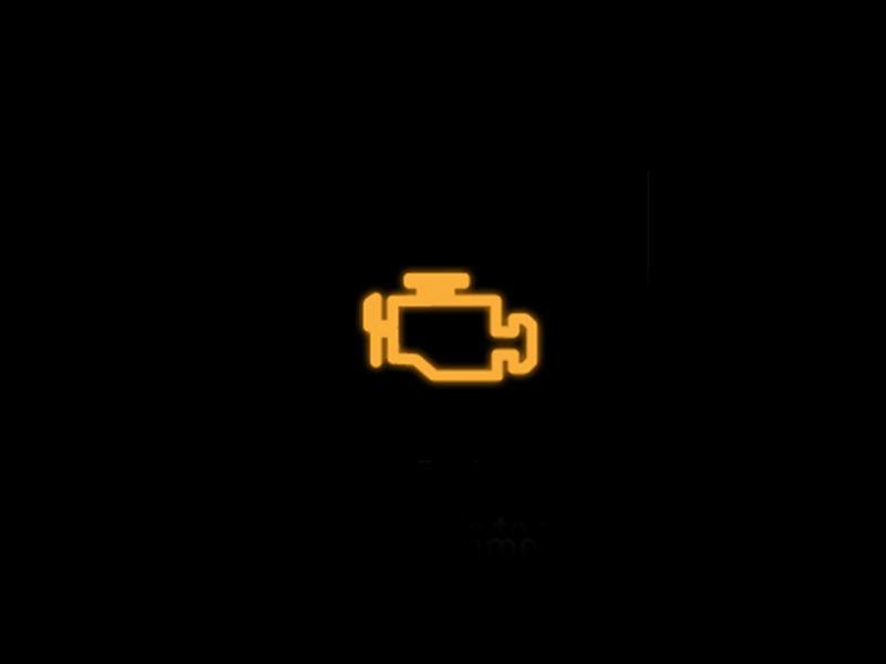 Yellow emission control/engine management warning light