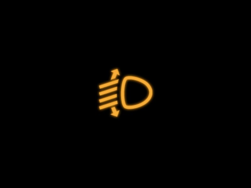 yellow headlight range control warning light