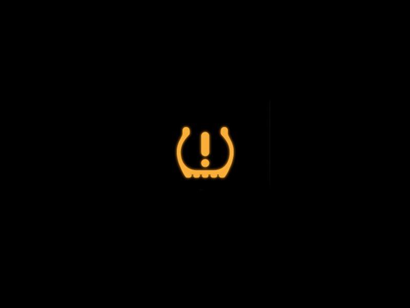 Yellow tyre pressure monitoring system warning light