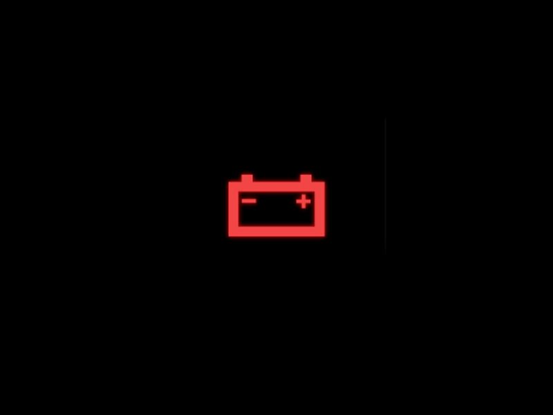 Red vehicle charging system warning light