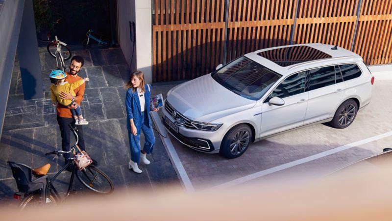 Family outside new Volkswagen