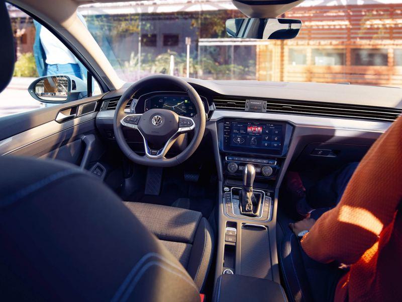 Interior shot of a Volkswagen Passat steering wheel and dashboard.