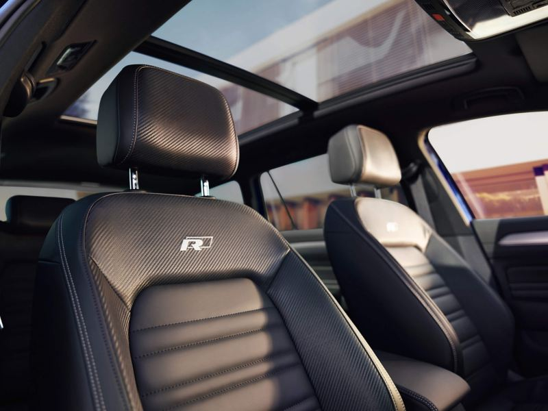 Interior shot of a Volkswagen Passat seats and sunroof.
