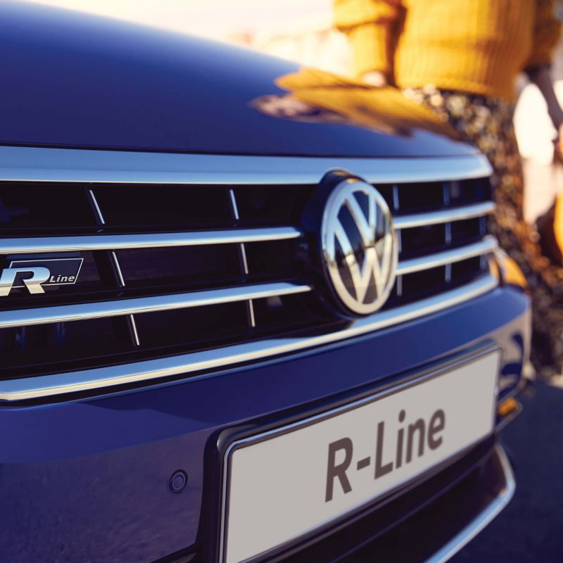 Front grill and badge shot of a blue Volkswagen Passat R-Line.
