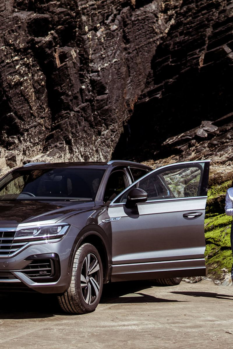 A Volkswagen Touareg parked in the mountains