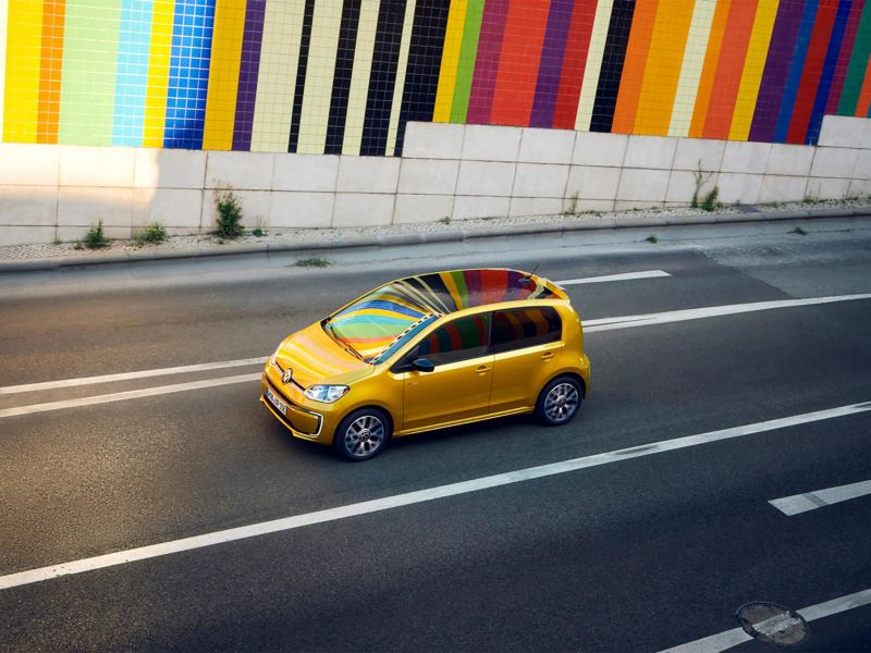 e-up! driving in front of coloured wall