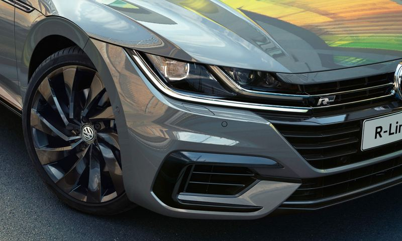 The headlights of a grey Arteon R-Line Edition