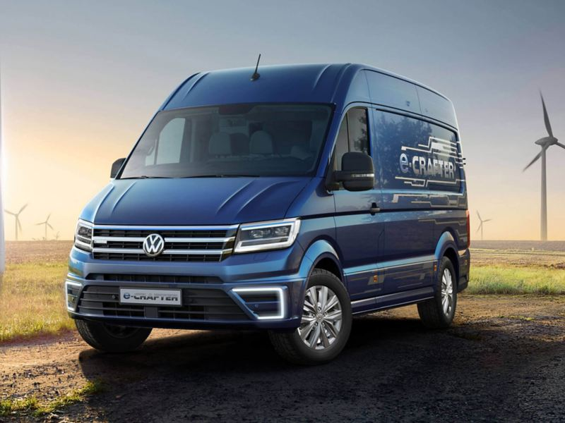 A blue Volkswagen e-Crafter van from 3/4 front view