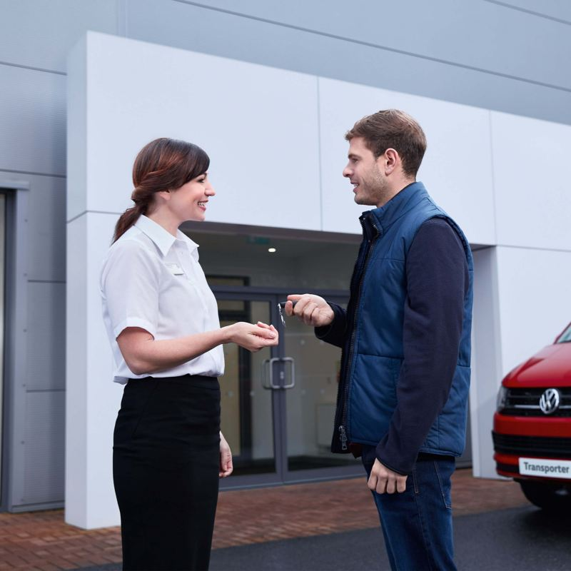 A Volkswagen retailer handing over the car keys to a customer