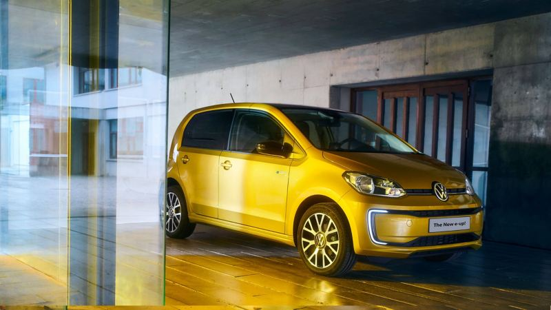 A 3/4 front exterior shot of a yellow new e-up!