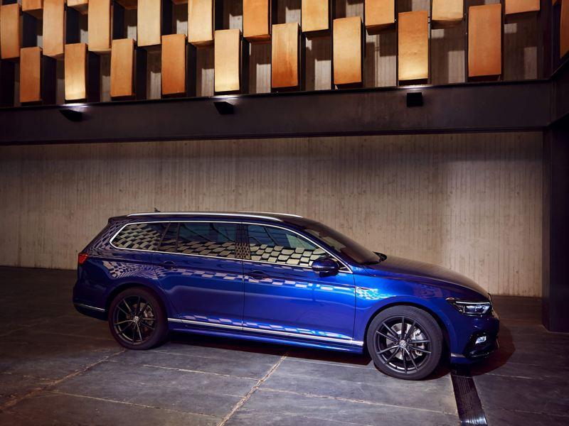 A blue Volkswagen Passat Estate in an underground car park.