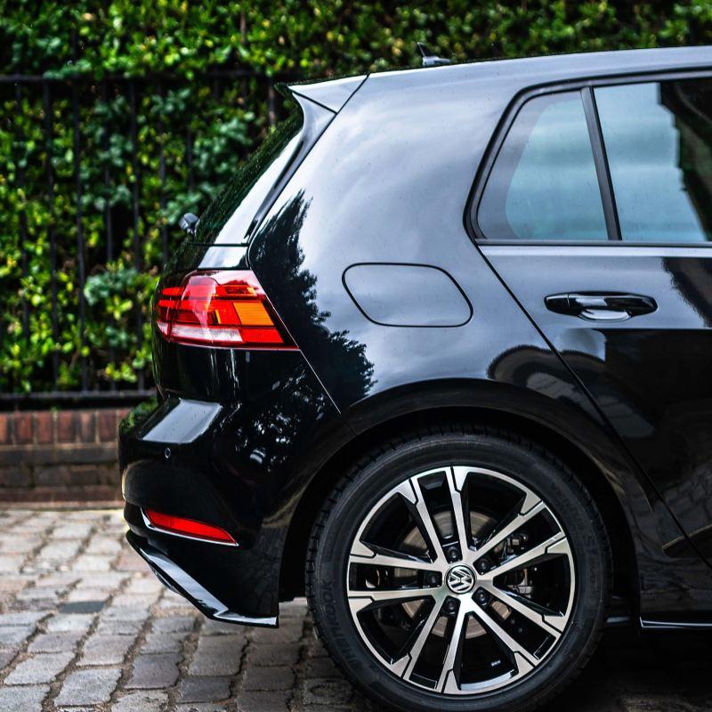 A black Volkswagen Golf.