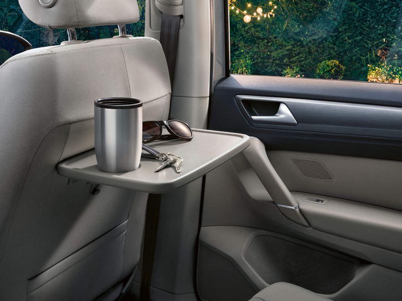 Interior shot of folding passenger tables in the Volkswagen Golf SV.