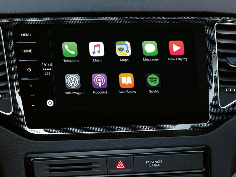 Dashboard in-car screen showing radio and navigation apps.