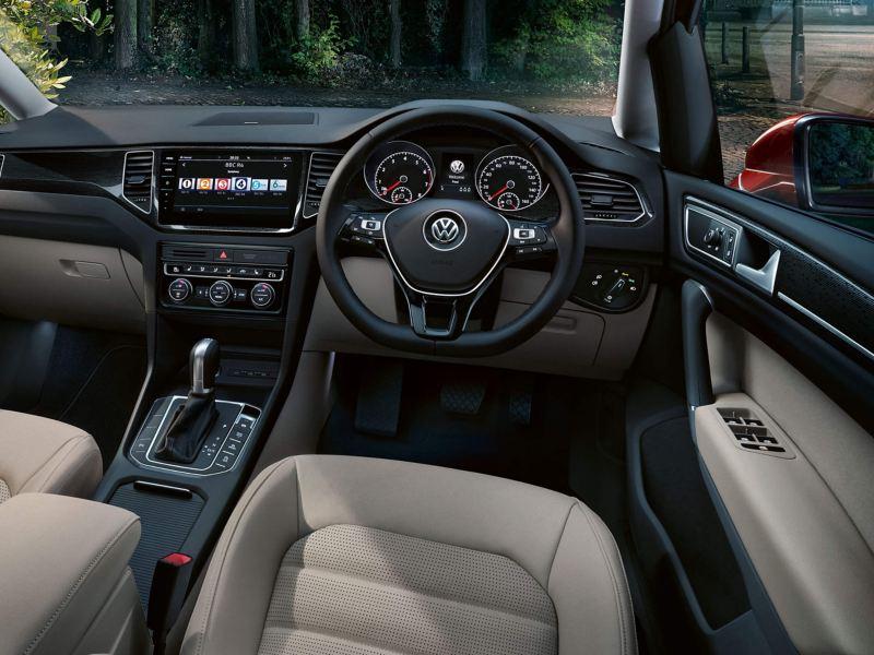 Interior steering wheel and dashboard shot of a Volkswagen Golf SV.