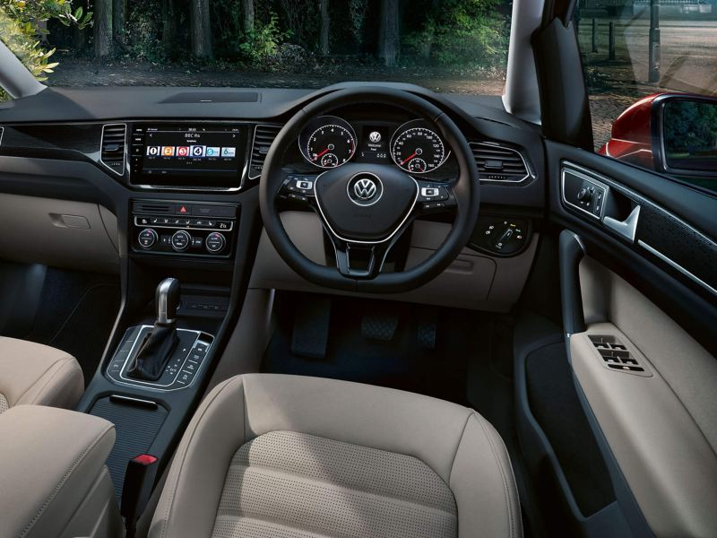 Interior steering wheel and dashboard shot of a Volkswagen Golf SV.