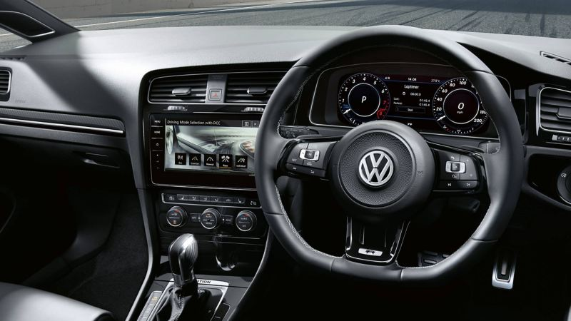 Interior shot of the Volkswagen Golf dash board and steering wheel.