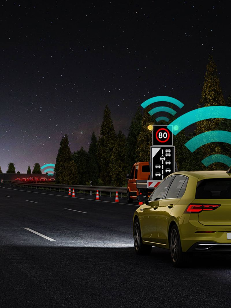 A yellow new Volkswagen Golf 8 driving on the highway in the night