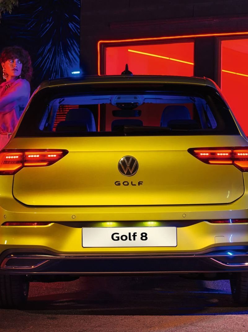 A couple getting in their new Volkswagen Golf 8