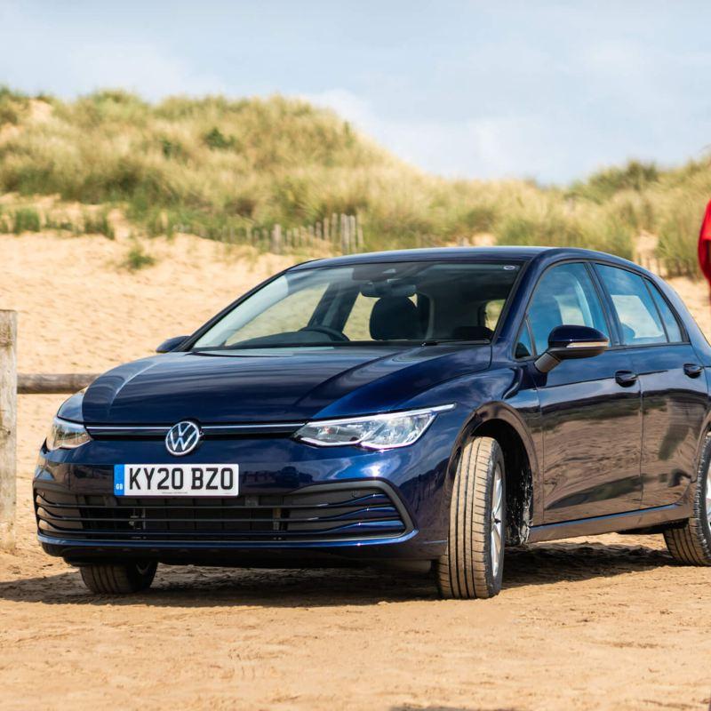 A blue new Golf 8 at the beach
