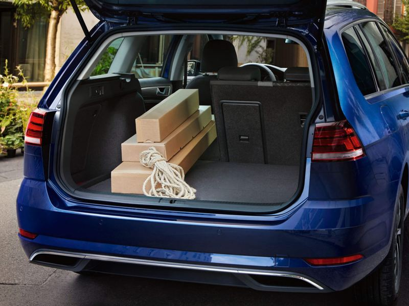 Boot capacity shown with large boxes, in a blue Volkswagen Golf Estate.