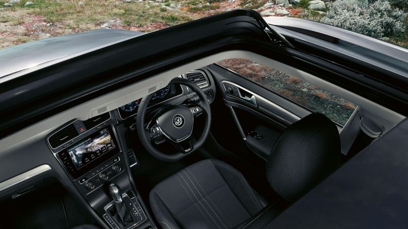 Volkswagen Golf Estate interior showing the driver's seat, sterring wheel, dashboard and the centre console with touchscreen