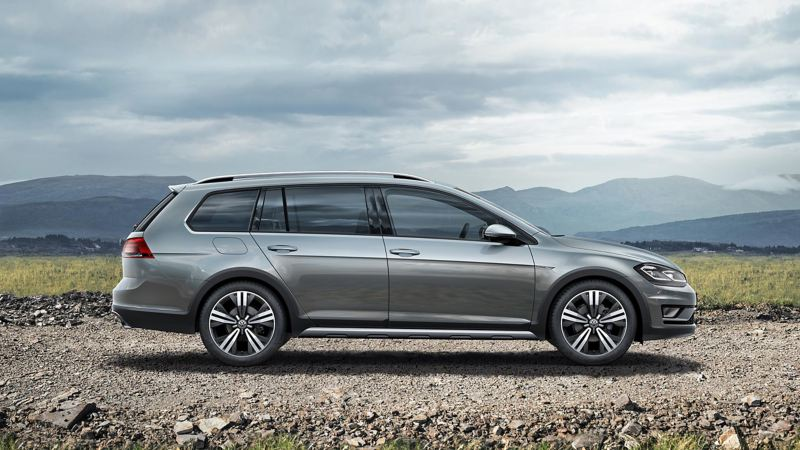 A grey Volkswagen Golf Estate, in the mountains.