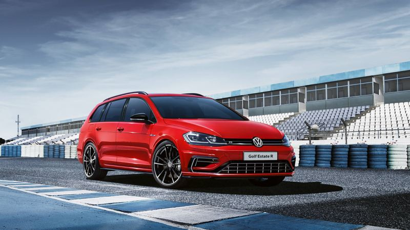 A red Volkswagen Golf Estate R, on a race track.