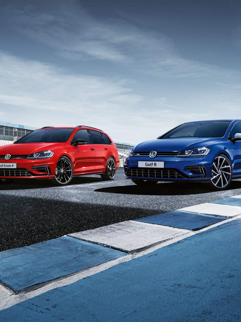 A red Volkswagen Golf Estate R and a blue Golf R on a race track.
