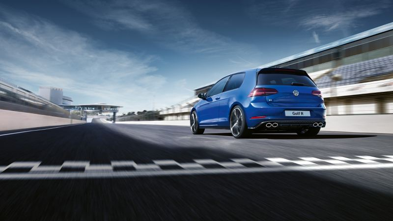 A blue Volkswagen Golf R on a race track.