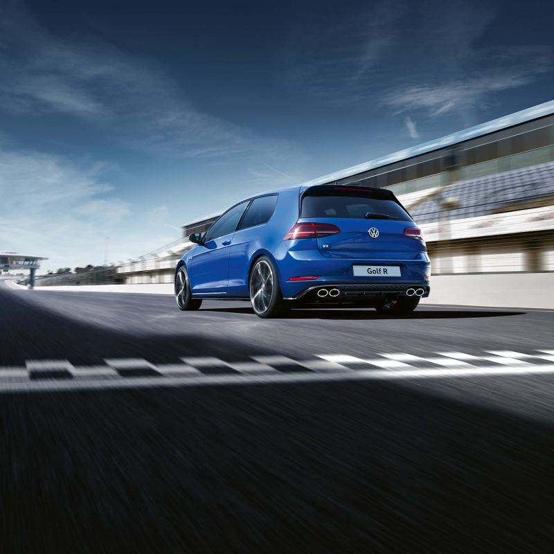 A blue Volkswagen Golf R driving on a race course