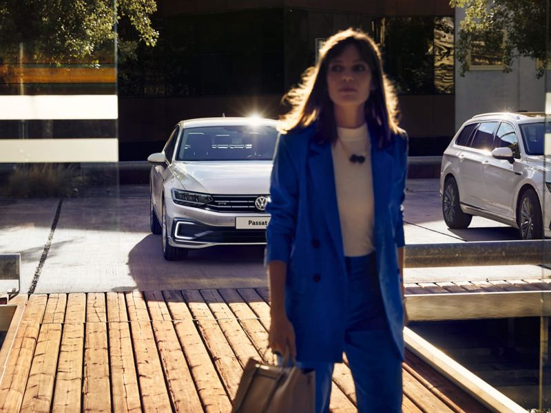 Woman walking away from her Volkswagen Passat GTE