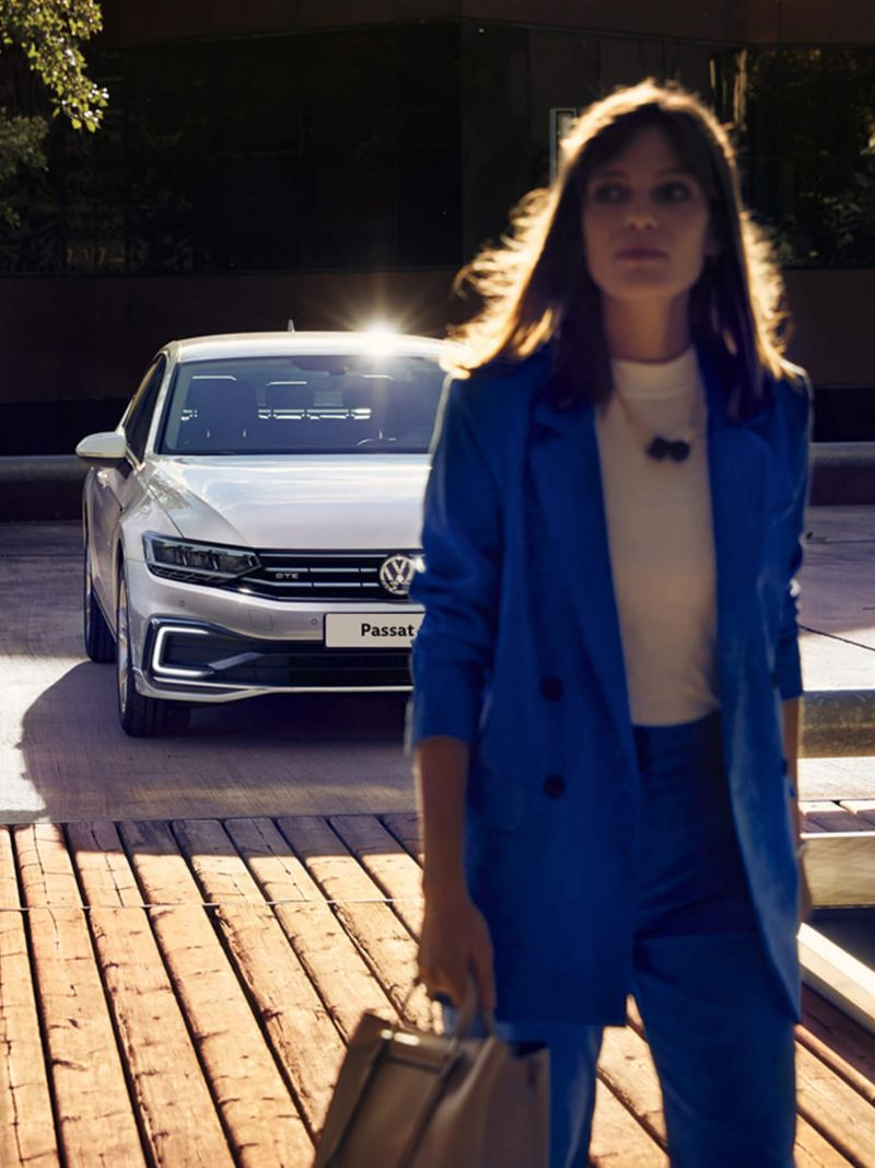 Woman walking away from her Volkswagen Passat GTE