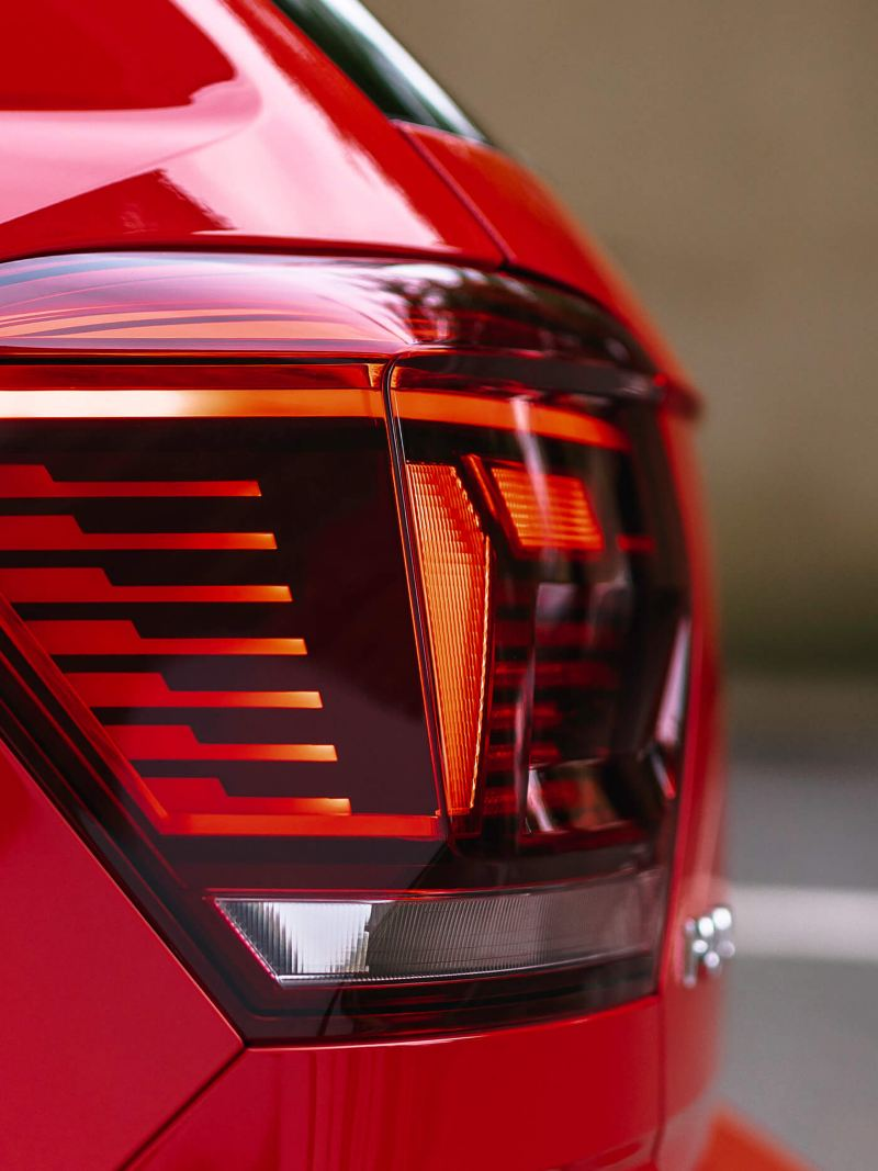The rear light of a red Polo
