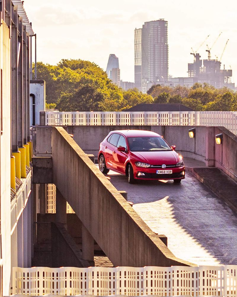 A Red Polo, driving down a ramp.