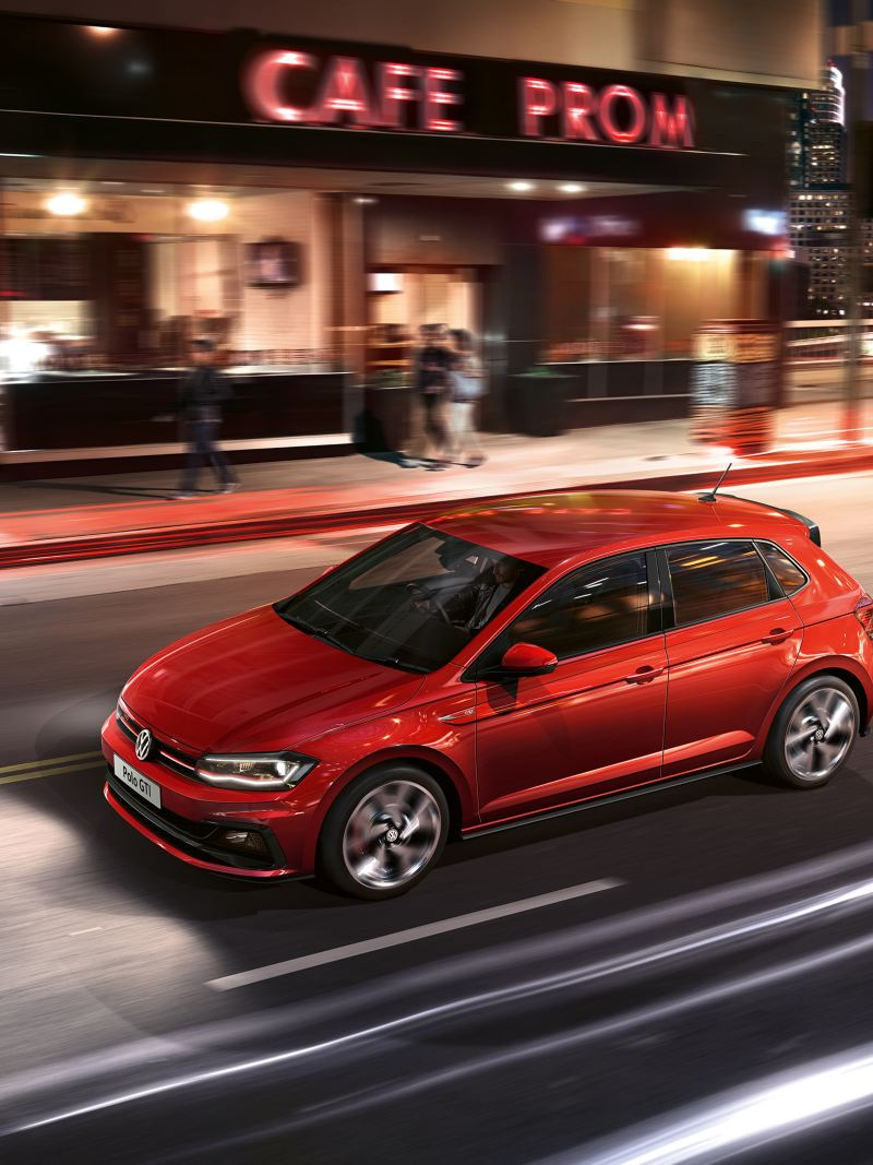 Volkswagen Polo GTI driving through city street