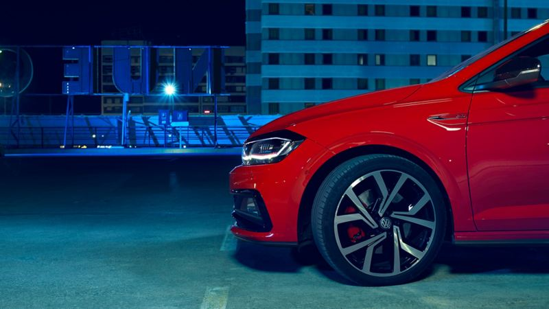 Profile view of a red Volkswagen Polo GTI wheels.