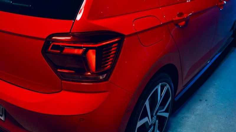 Rear brake-light shot of a red Volkswagen Polo GTI.