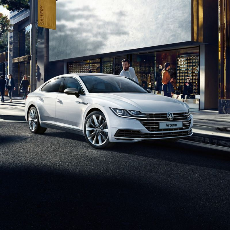 A man getting out of a white arteon