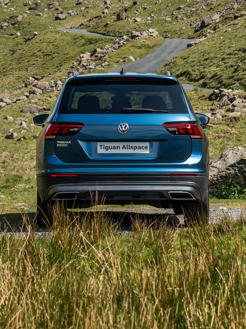 A blue Tiguan Allspace in the countryside.