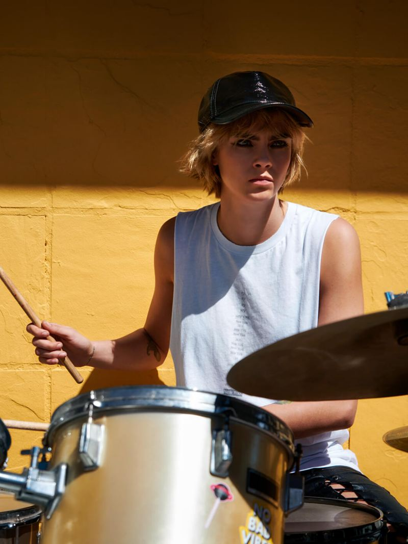 Shot of Cara Delevingne playing drums